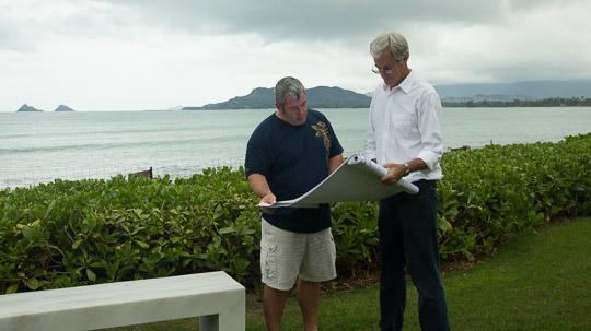 Douglas Saulsbury, right, discusses landscape plans with a client.